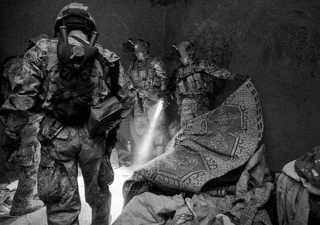 Category: Combat camera operational, first place Afghan National Army special operations and coalition forces search a compound March 23, 2012, in Southern Afghanistan during a raid targeting a Taliban sub-commander. Staff Sgt. Sean K. Harp / U.S. Army