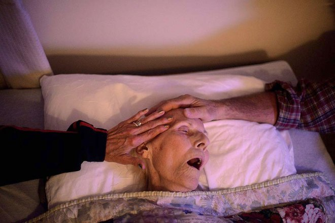 Category: Features, first place Retired Air Force Lt. Col. Robert Lock and his wife, Chris, comfort his mother, Mary, as she takes her last breaths before passing away Oct. 22 at a nursing facility in Gloversville, N.Y. She was 87. Master Sgt. Jeremy Lock / U.S. Air Force